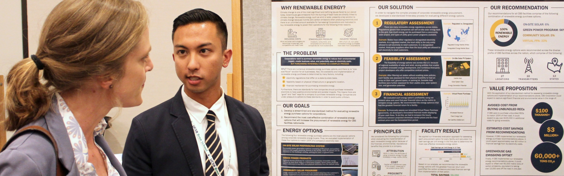 Student presents his research poster to a woman