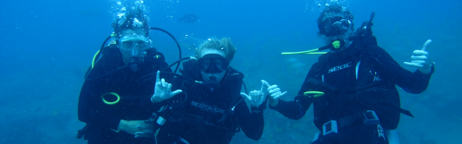 SCUBA divers making hang loose hand signs
