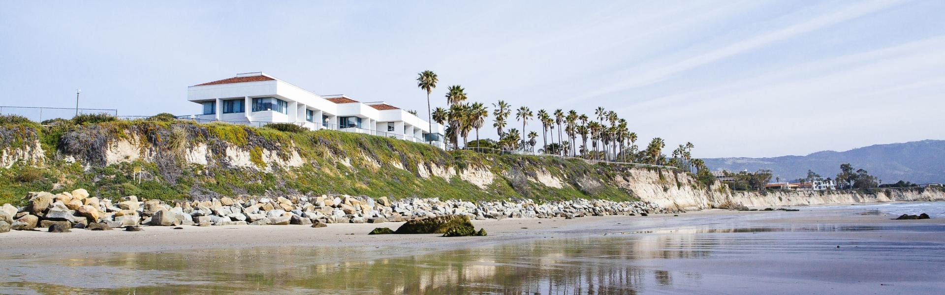 Building on beach cliff