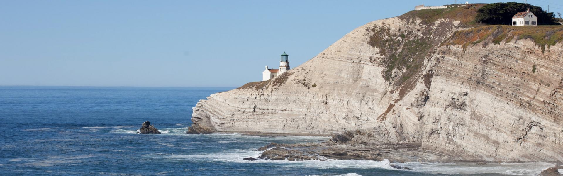Lighthouse on cliffs overlooking ocean
