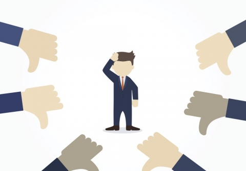 graphic of confused man surrounded by hands giving thumbs-down gestures