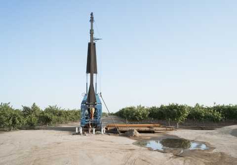 Groundwater drilling equipment in a field