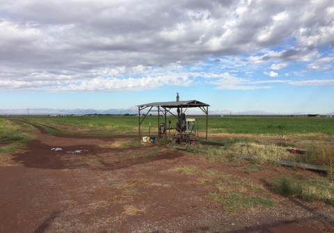 A groundwater well in a field