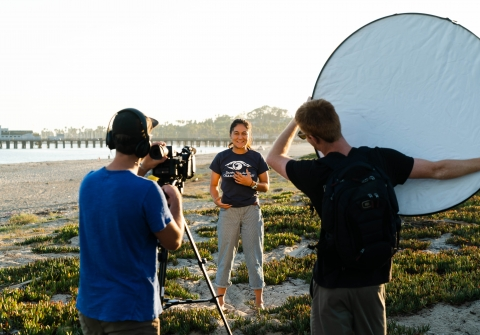 Students in a video shoot on the beach