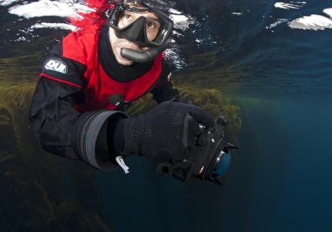 Octavio Aburto in dive gear underwater