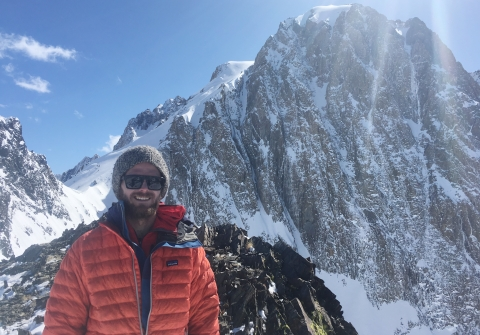 Timbo Stillinger stands on a snowy mountain