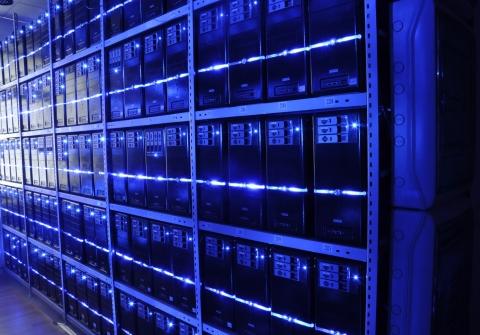 Bank of computer servers lit up blue