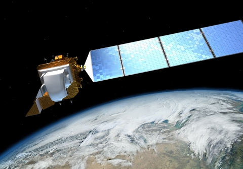 Artist's rendition of a satellite over earth in space