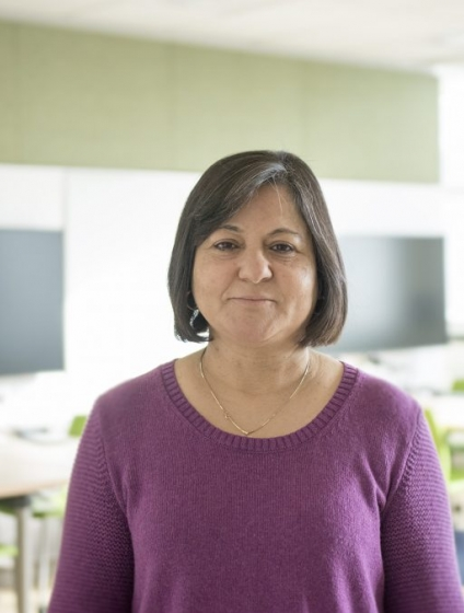 Madhu Khanna stands in a classroom