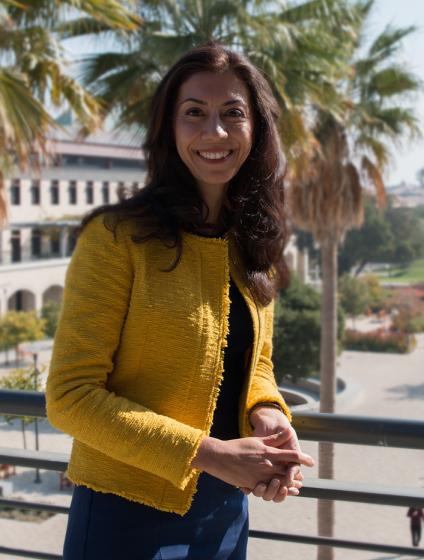 Newsha Ajami stands on a balcony
