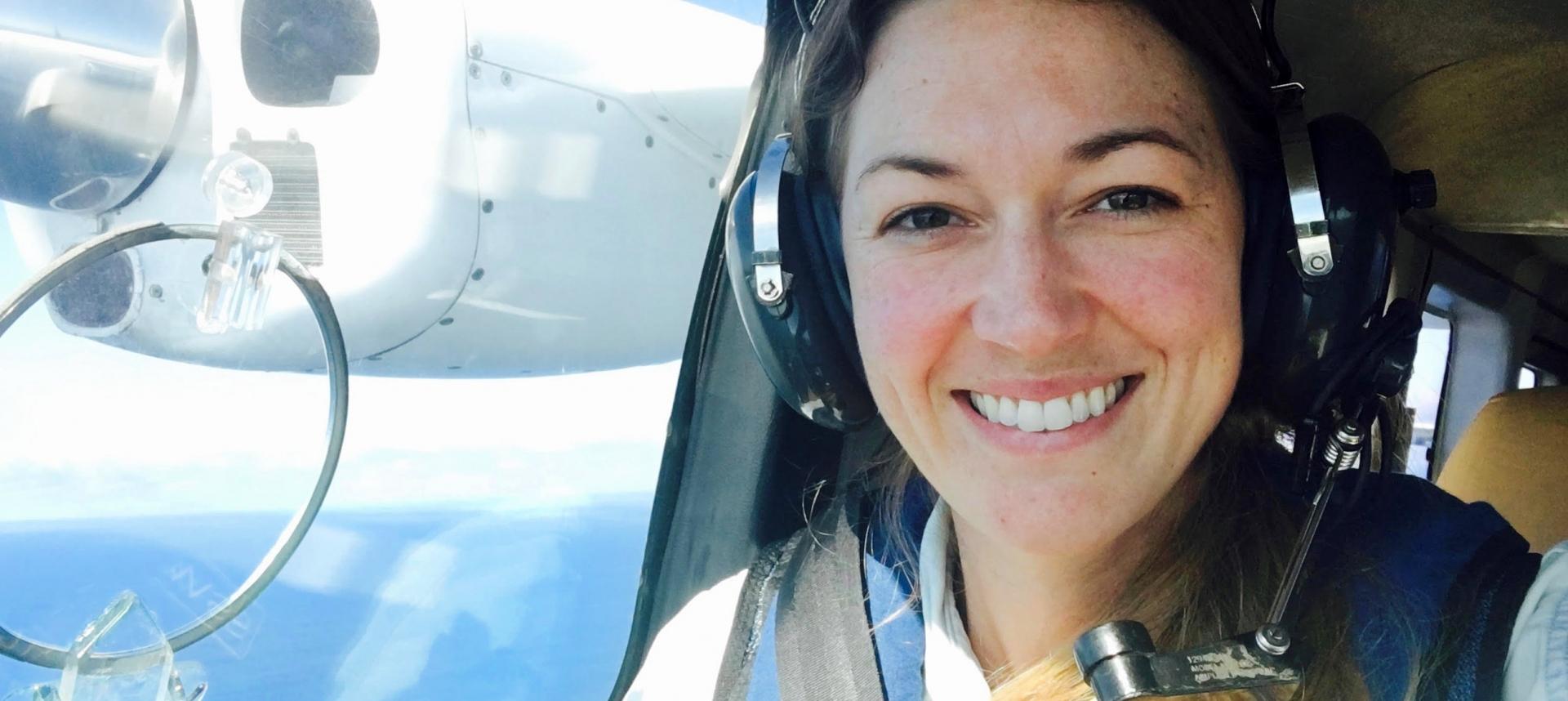 Smiling woman passenger on plane