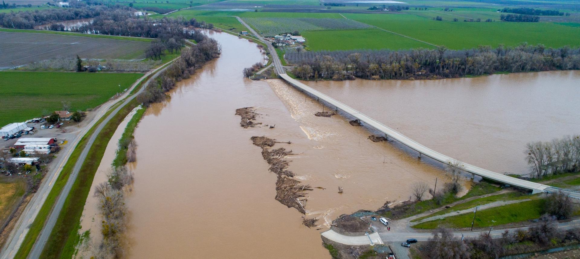 Sacramento River flooded into farmlands and highway