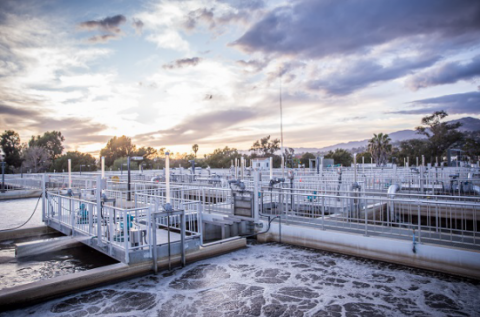 Sunset over wastewater treatment tanks