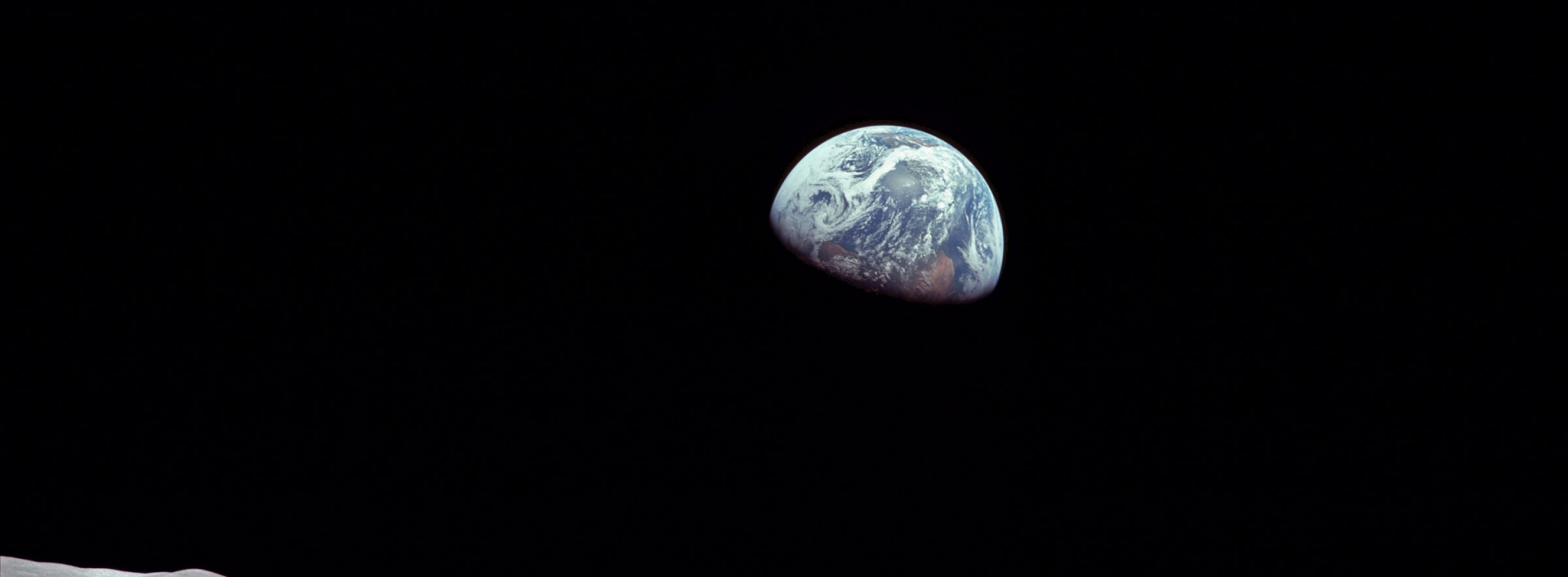 Earth rising over the moon from space