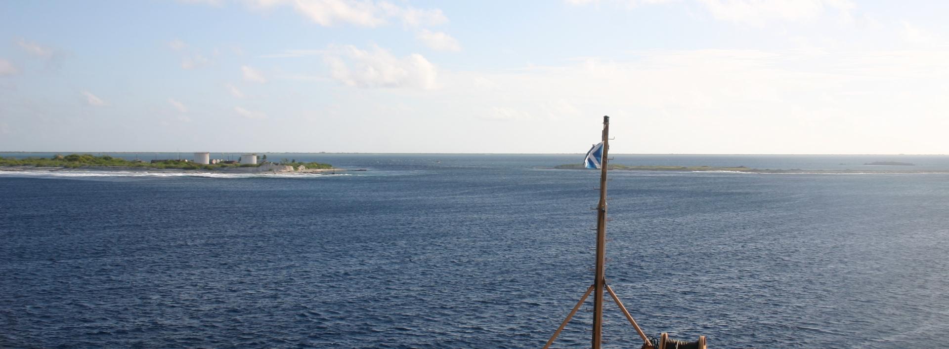Calm ocean and small island shore