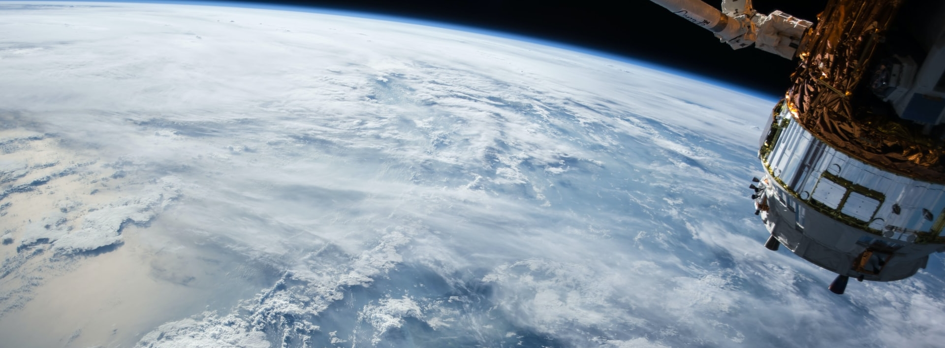 View of Earth from space with satellite