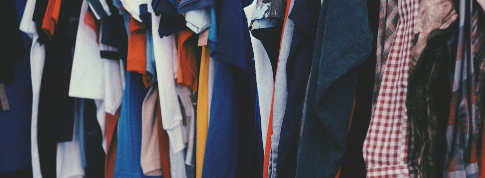 Colorful clothing hanging in a closet