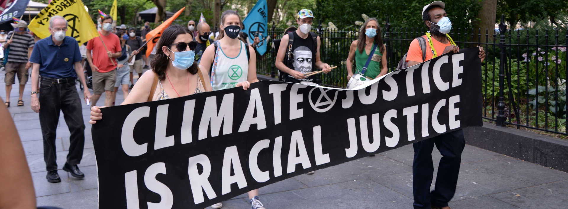 Climate justice march holding banner