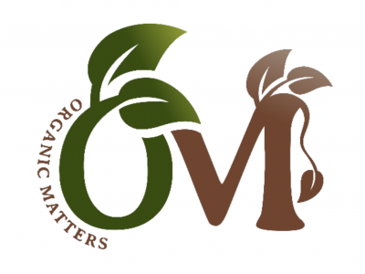 business logo O and M with leaf art