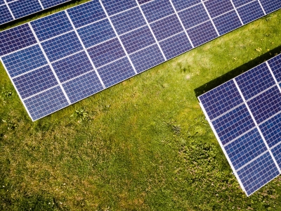 Aerial view of solar panels on grass