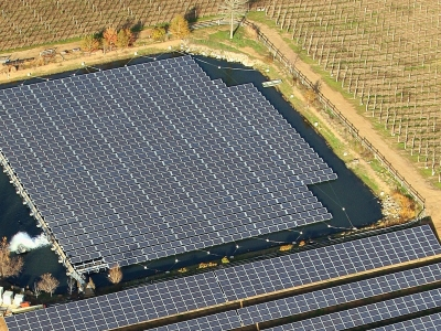 Aerial view of solar panels floating in pond