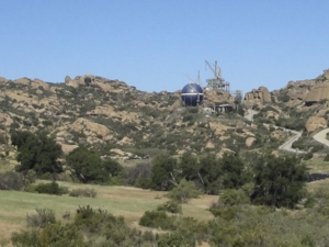 Building sitting in rocky foothills