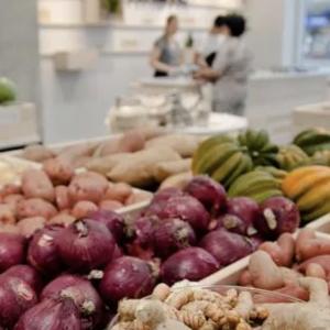 vegetables in bins in a store