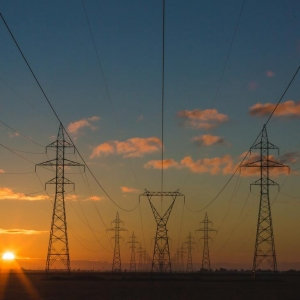 Sunset behind large electrical towers